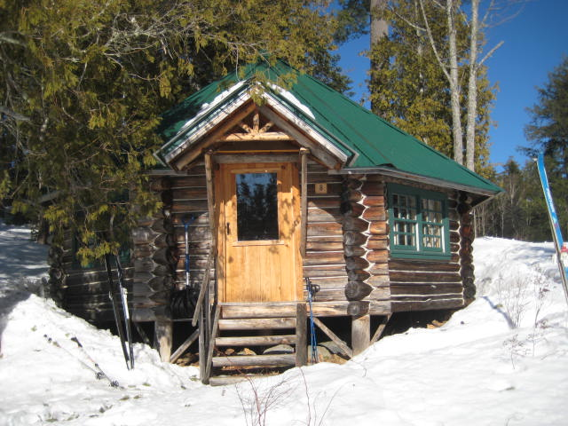 The Library, which sits just steps away from Long Pond. Several of the rebuilt cabins at Gorman now have bathrooms, although the Library retains its 19th century rustic ambience (a walk up the hill to use the facilities).