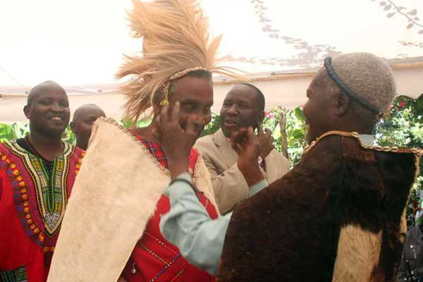 William ole Ntimama being installed as a Meru elder by Mzee John M'Rukunga when he toured a privately owned museum at Ruiga village in Central Imenti district on March 25, 2009. Mr Ntimama later toured Katheri village in the same district where he was born. FILE PHOTO | CHARLES WANYORO | NATION MEDIA GROUP