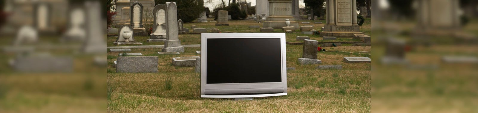 Flat panel television set in cemetary.