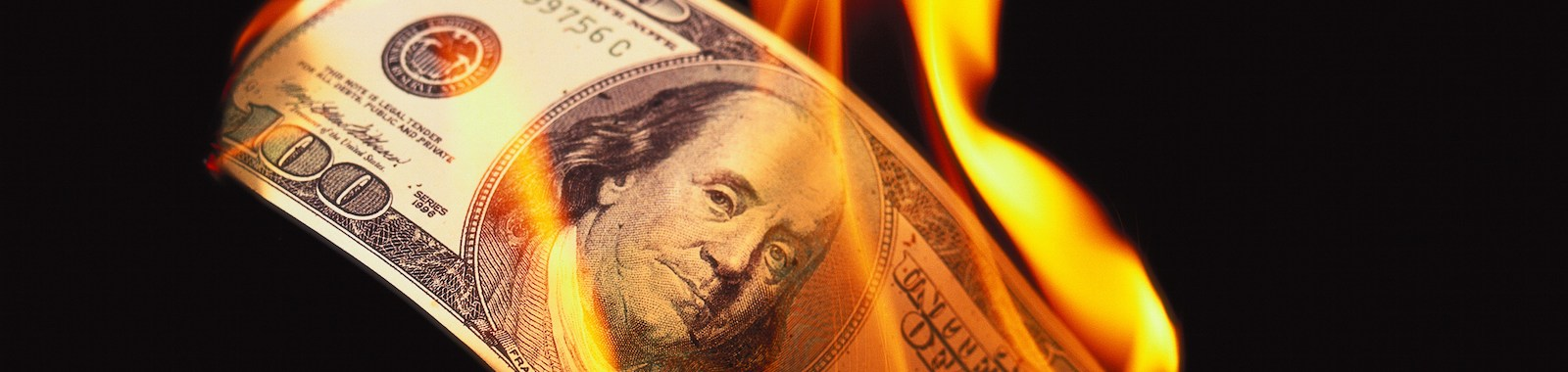 close-up of currency burning