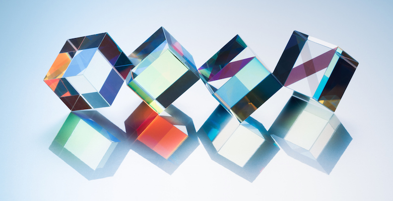 X-cube Prism in a Row on Silver Background Close-up View