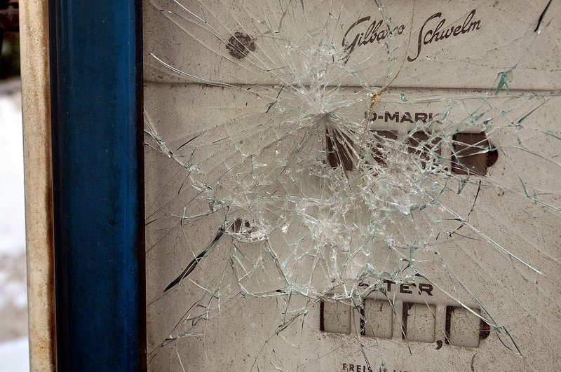 smashed glass gas pump
