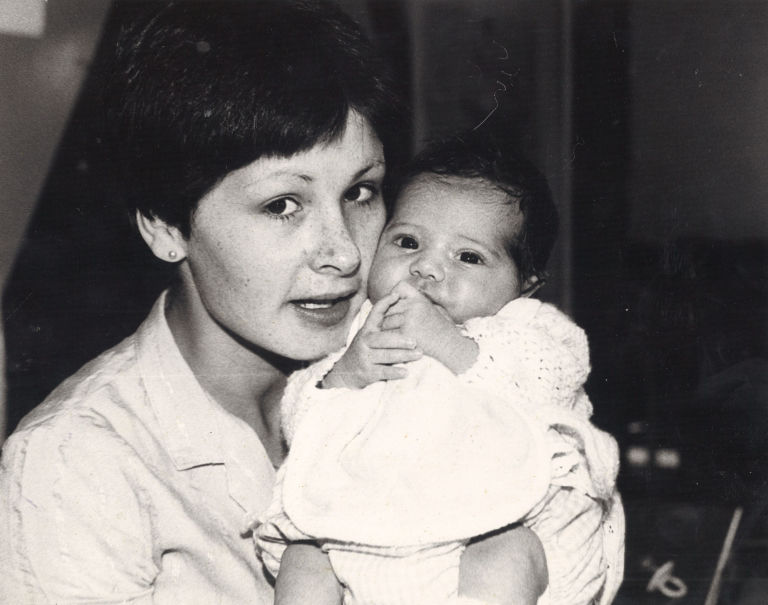 Cheryl's mother holding her as a baby in 1983. (Who Do You Think You Are?)