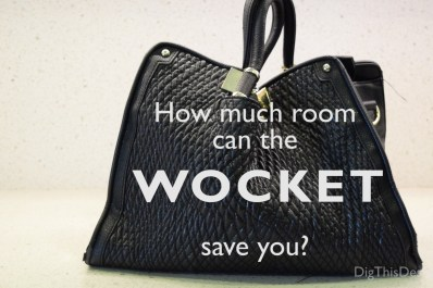 How much room can the Wocket smart wallet save you? Black purse on a white counter top