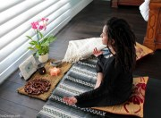 Items for a simple minimalist meditation space inside the home.