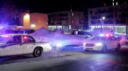 Police survey the scene after deadly shooting at a mosque in Quebec City, Canada, Sunday, Jan. 29, 2017. (AP)