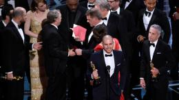 "Fred Berger, producer of ""La La Land,"" (foreground center) gives his acceptance speech at the Oscars on Sunday, Feb. 26, 2017, at the Dolby Theatre in Los Angeles. The actual winner of best picture went to ""Moonlight."" (AP)"