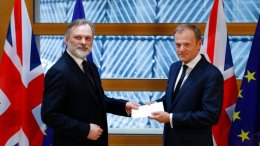 Britain's permanent representative to the European Union Tim Barrow, left, hand delivers British Prime Minister Theresa May's Brexit letter in notice of the UK's intention to leave the bloc under Article 50 of the EU's Lisbon Treaty to EU Council President Donald Tusk, in Brussels, Belgium, Wednesday, March 29, 2017. (AP)