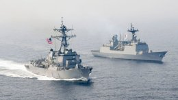 In this Tuesday, April 25, 2017, photo released by the U.S. Navy, the Arleigh Burke-class guided-missile destroyer USS Wayne E. Meyer (left) is underway alongside the Republic of Korea multirole guided-missile destroyer Wang Geon during a bilateral exercise. (AP)