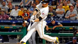 Pittsburgh Pirates' Max Moroff drives in the winning run with a single off Milwaukee Brewers relief pitcher Jared Hughes during the 10th inning of a baseball game in Pittsburgh, Wednesday, July 19, 2017. The Pirates won 3-2. (AP)