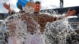 Pittsburgh Pirates' Chris Stewart gets doused by Josh Bell as he waits to be interviewed after a 4-2 Pirates win over the Milwaukee Brewers in a baseball game in Pittsburgh, Thursday, July 20, 2017. (AP)