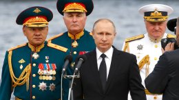 Russian President Vladimir Putin (center), Defense Minister Sergei Shoigu (left), Commander-in-Chief of the Russian Navy Vladimir Korolev (right), and Commander of Western military district Andrei Kartapolov arrive to attend the military parade during the Navy Day celebration in St. Petersburg, Russia, on Sunday, July 30, 2017.  (AP)