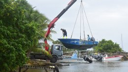 Men remove boats from the water ahead of Hurricane Maria in the Galbas area of Sainte-Anne on the French Caribbean island of Guadeloupe, early Monday, Sept. 18, 2017. (AP)