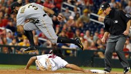 Pittsburgh Pirates third baseman Sean Rodriguez (3) leaps over Washington Nationals' Anthony Rendon (6) after he tagged out Rendon during the first inning of a baseball game, Thursday, Sept. 28, 2017, in Washington. (AP)