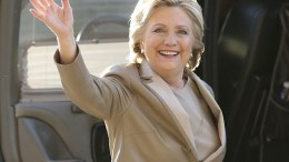 "FILE - In this Nov. 8, 2016 file photo, Democratic presidential candidate Hillary Clinton waves as she arrives to vote at her polling place in Chappaqua, N.Y. Vanity Fair is trying to defuse criticism of a video mocking Clinton and her presidential aspirations. In a statement Wednesday, Dec. 27, 2017, the magazine said the online video was an attempt at humor that regrettably ""missed the mark."" (AP Photo/Seth Wenig, File)"