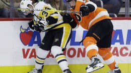 Pittsburgh's Tom Kuhnhackl (left) battles along the boards for the puck with Philadelphia's Radko Gudas during Tuesday night's game.