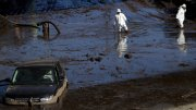 A work crew cleans up an area of Highway 101 that flooded in Montecito, Calif., Friday, Jan. 12, 2018. (AP)