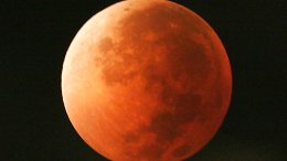 In this Aug. 28, 2007, file photo, the moon takes on different orange tones during a lunar eclipse seen from Mexico City. During a lunar eclipse, the moon's disk can take on a colorful appearance from bright orange to blood red to dark brown and, rarely, very dark gray. On Wednesday, Jan. 31, 2018, a super moon, blue moon and a lunar eclipse will coincide for first time since 1982 and will not occur again until 2037. (AP)