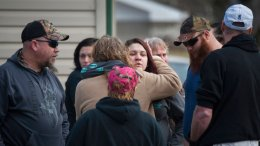 People hug at the scene where a shooter killed four people Sunday, Jan. 28, 2018, outside Ed's Carwash in Saltlick Township, Fayette County, Pa. (AP)