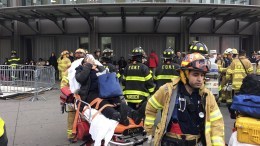 FILE - In this Jan. 4, 2017, file photo, an injured passenger is taken from the Atlantic Terminal in the Brooklyn borough of New York after a Long Island Rail Road train hit a bumping block. President Donald Trump is putting the brakes on attempts to address dangerous transportation safety problems from speeding tractor-trailers to sleepy railroad engineers as part of his quest to roll back regulations across the government. (AP Photo/Mark Lennihan, File)