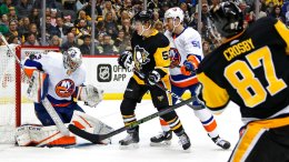 New York Islanders goaltender Christopher Gibson (33) stops a shot by Pittsburgh Penguins' Sidney Crosby (87) in the second period of an NHL hockey game in Pittsburgh, Saturday, March 3, 2018. (AP)