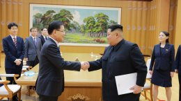 North Korean leader Kim Jong Un (front, right) shakes hands with South Korean National Security Director Chung Eui-yong after Chung gave Kim the letter from South Korean President Moon Jae-in, on Monday, March 5, in Pyongyang, North Korea. (AP)