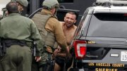 Los Angeles County Sheriff deputies escort a handcuffed man suspected of fatally shooting a Pomona police officer to a waiting car Saturday, March 10, 2018, in Pomona, Calif. (AP)