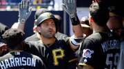 Pittsburgh Pirates' Francisco Cervelli celebrates with Josh Harrison (5) and Joe Musgrove (59) after hitting a two-run home run off New York Yankees starting pitcher Sonny Gray during the first inning of a spring training baseball game Thursday, March 15, 2018, in Tampa, Fla. (AP)
