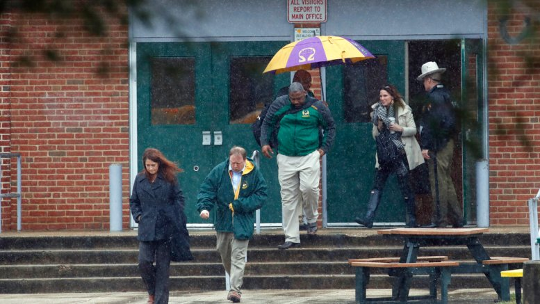Teachers and school employees depart Great Mills High School, the scene of a shooting, Tuesday, March 20, 2018 in Great Mills, Md.  (AP)