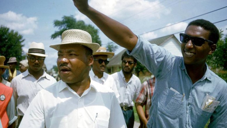 """This 1966 image released by HBO shows Dr. Martin Luther King, Jr., left, and Stokely Carmichael in Jackson, Miss., at the Meredith March, used in the documentary, """"King in the Wilderness."""" (HBO via AP)"""