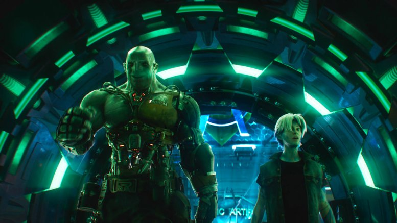 """This cover image released by Warner Bros. Pictures shows characters Aech, left, and Parzival in a scene from """"Ready Player One,"""" a film by Steven Spielberg. (AP)"""