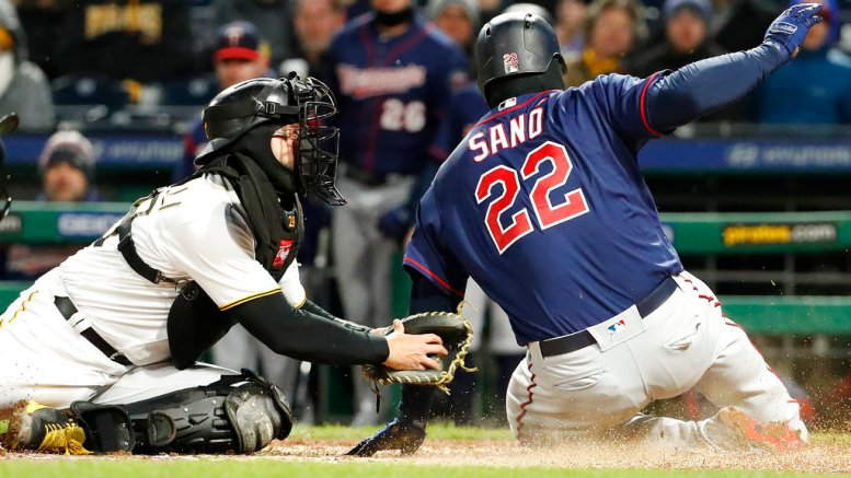 Minnesota Twins' Miguel Sano (22) slides past the attempted tag by Pittsburgh Pirates catcher Francisco Cervelli to score on a double by Logan Morrison off Pirates starting pitcher Ivan Nova during the sixth inning of a baseball game in Pittsburgh, Wednesday, April 4, 2018. (AP)