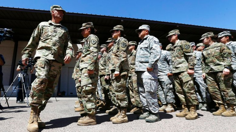 Arizona National Guard soldiers line up as they get ready for a visit from Arizona Gov. Doug Ducey prior their deployment to the Mexico border at the Papago Park Military Reservation Monday, April 9, 2018, in Phoenix. (AP)