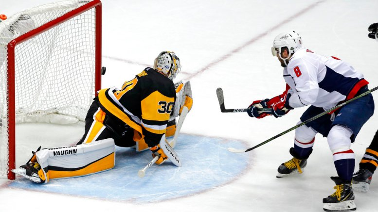 Washington Capitals' Alex Ovechkin (8) puts the go-ahead goal behind Pittsburgh Penguins goaltender Matt Murray (30) during the third period in Game 3 of an NHL second-round hockey playoff series in Pittsburgh, Tuesday, May 1, 2018. The Capitals won 4-3. (AP)
