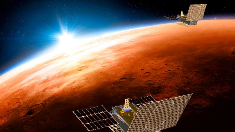 This illustration made available by NASA on March 29, 2018 shows the twin Mars Cube One (MarCO) spacecraft flying over Mars with Earth and the sun in the distance. (AP)