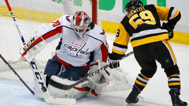 Washington Capitals goaltender Braden Holtby (70) stops a shot by Pittsburgh Penguins' Jake Guentzel (59) during the first period in Game 4 of an NHL second-round hockey playoff series in Pittsburgh, Thursday, May 3, 2018. (AP)
