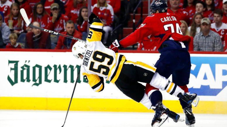 Washington Capitals defenseman John Carlson (74) collides with Pittsburgh Penguins center Jake Guentzel (59) during the first period of Game 5 in the second round of the NHL Stanley Cup hockey playoffs, Saturday, May 5, 2018, in Washington. (AP)