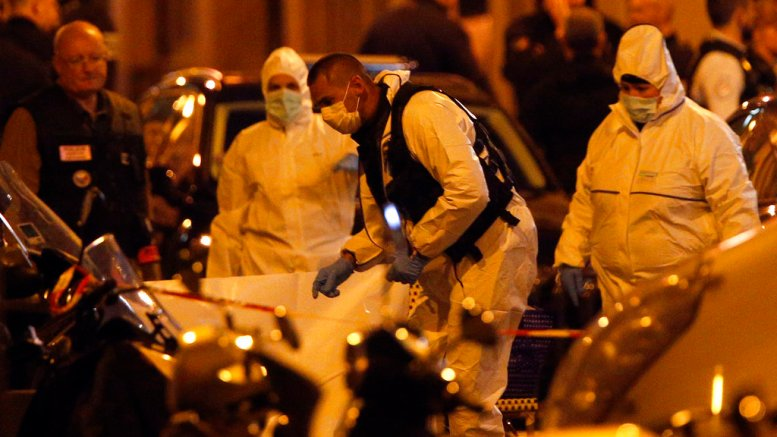 Scientific police officers investigate after a knife attack in central Paris, Saturday May 12, 2018. (AP)