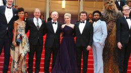 Actors Joonas Suotamo (from left), Thandie Newton, Woody Harrelson, director Ron Howard, actress Emilia Clarke, actor Alden Ehrenreich, actor Donald Glover, a person dressed as the character Chewbacca and actor Paul Bettany pose for photographers upon arrival at the premiere of the film 'Solo: A Star Wars Story' at the 71st international film festival, Cannes, southern France, Tuesday, May 15, 2018. (AP)