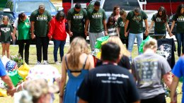 Houston Texans players join in a prayer circle at a memorial for the Santa Fe High School shooting victims outside the school Wednesday, May 23, 2018, in Santa Fe, Texas. (AP)
