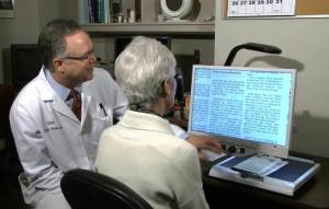Patient working with a low vision therapist