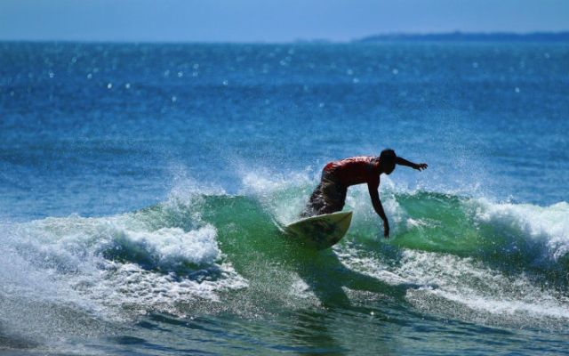 Kuta Beach is one of the most popular places to learn how to surf in Bali.