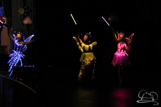 Fairies light up the night in Disneyland's Paint the Night Parade.