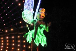 Tinker Bell leads the way in Disneyland's Paint the Night Parade.