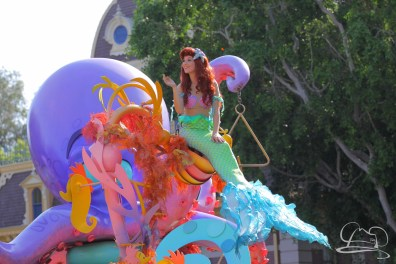Ariel waves to Disneyland guests in front of City Hall in Mickey's Soundsational Parade.