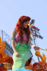 The Little Mermaid waves to little fans at Disneyland in Mickey's Soundsational Parade.