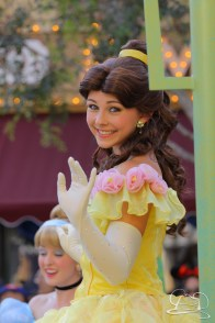 Belle waves in Mickey's Soundsational Parade.