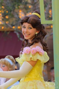 A smile from Belle lightens up Mickey's Soundsational Parade.