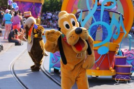 Pluto dances the day away in Mickey's Soundsational Parade.