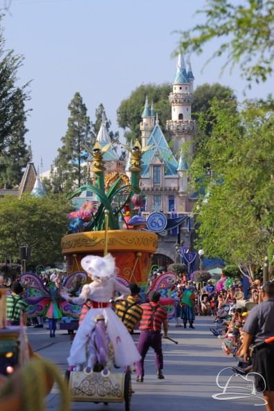 Mickey's Soundsational Parade with Sleeping Beauty Castle in the background as it makes its way down Main Street, USA at Disneyland.